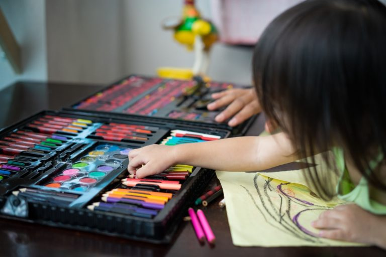 toddler-choosing-colours-while-drawing-on-a-paper-at-home-.jpg